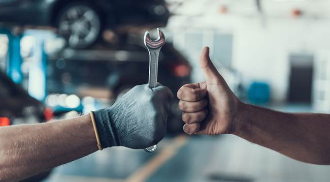 person giving thumbs up to an engineer